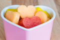 Valentines day child friendly healthy treat with heart shaped fruit cantaloupe watermelon and pineapple Royalty Free Stock Images