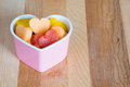 Valentines day child friendly healthy treat with heart shaped fruit cantaloupe watermelon and pineapple Stock Image