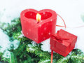 Valentines day or christmas winter still life with gift and candle outdoor heart shaped red on snowy pine branch Stock Image