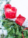 Valentines day or christmas winter still life with gift and candle outdoor heart shaped red on snowy pine branch Royalty Free Stock Photography
