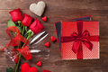 Valentines day gift box and red roses Royalty Free Stock Photo