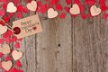 Valentines Day gift tag with heart corner border on wood Royalty Free Stock Photo