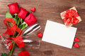 Valentines day greeting card, gift box and red roses Royalty Free Stock Photo