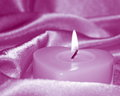 Valentines day holiday card stock photo romantic lit candle on pink purple silk background Royalty Free Stock Images
