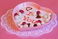 Valentines day or mothers day card stock photos gift chocolate heart with white chocolates on pink background Stock Photos