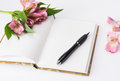 Valentines day mothers day composition love diary and fresh spring flowers white background copy space Stock Photo