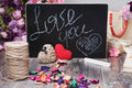 Valentines day photo frame or greeting card and handmade hearts over wooden table. Royalty Free Stock Photo