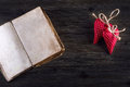 Valentines day. Red cloth handmade hearts and old open book on wooden background Royalty Free Stock Photo