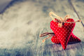 Valentines day. Red cloth handmade hearts on wooden background Royalty Free Stock Photo