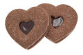 Valentines heart shaped chocolate cookie biscuits two biscuit with a raspberry jam centre studio shot with a white background Royalty Free Stock Photo