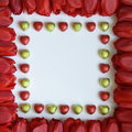 Valentines or mothers day frame stock photos tulips and chocolates red tulip flowers and heart shaped candies on white paper Royalty Free Stock Images