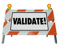 Validate word barricade verify truth status certify results on a road construction barrier or to illustrate certifying or Stock Photography