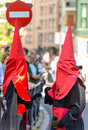 Valladolid good thursday spain – april two red and black nazarenos in the religious processions during holy week on on april in Stock Photo