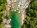 Valle Verzasca - Aerial View of clear and turquoise water stream and rocks in Verzasca River in Ticino - Verzasca Valley in Tessin Royalty Free Stock Photo