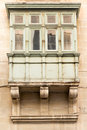 Valletta balconies on traditional maltese house in the capital city of malta Stock Photo
