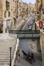 Valletta island of malta street in the city on the mediterranean british style telephone box Stock Photos