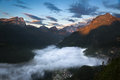 Valley in Dolomites with early morning clouds, Alps, Italy Royalty Free Stock Photo