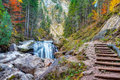 Valley with watercourse and waterfalls in autumn near neuschwanstein germany taken in autumn october Royalty Free Stock Image