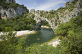 Vallon pont d arc a natural bridge in the ardeche france stone arch over river Royalty Free Stock Photos