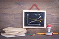 Value and Cost graph on chalkboard. Chalkboard on a wooden background Royalty Free Stock Photo