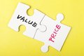 Value and price words written on two pieces of jigsaw puzzle Royalty Free Stock Photography