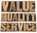 Value quality service business mantra concept isolated words vintage letterpress wood type printing blocks Stock Photography
