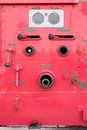 Valve control on fire engine truck look like human face Royalty Free Stock Photo