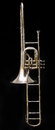 Valve trombone a silver antique on a black background Royalty Free Stock Photos