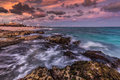 Vamos a la playa purple sunset over tropical rocky beach riviera maya yucatan mexico Stock Photo