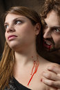 Vampire bites girl the neck of a Royalty Free Stock Photo