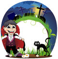 Vampire and black cat on a cemetery boy dressed as night halloween background Stock Photo