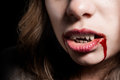 Vampire with the bloody teeth particularly mouth of a Royalty Free Stock Photography
