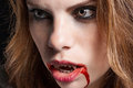 Vampire with the bloody teeth vvampire girl intense look Royalty Free Stock Photography