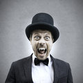 Vampire businessman scary screaming and showing fangs in vintage elegant outfit Stock Photo
