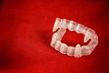 Vampire costume fangs on red classic halloween teeth with Royalty Free Stock Photos