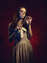 Vampire girl with a knife. Blood leaks from her eyes Royalty Free Stock Photo
