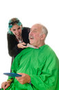 Vampire hairdresser female slitting the throat of an unsuspecting customer so as to drink the blood Stock Images