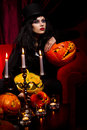 Vampire with halloween pumpkins concept sexy lady over red background Royalty Free Stock Images