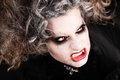 Vampire woman portrait with mouth showing teeth canines halloween make up open Stock Images