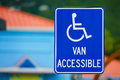 Van accessible sign for handicapped person Stock Photos