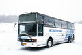Van hool t acron asha russia january white interurban coach at the snow field Royalty Free Stock Images
