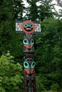 Vancouver b c canada a family admires stanley park totem pole display Royalty Free Stock Images