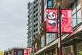 Vancouver, Canada - April 19, 2016: Chinatown in downtown with banner and panda culture symbol with text of since 1885 Royalty Free Stock Photo