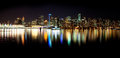 Vancouver skyline at night shot from stanley park on a summer pm a view of the beautiful city of british columbia canada Stock Image