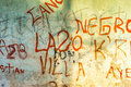 A vandalised wall green yellow has been with various graffiti tags Royalty Free Stock Images