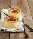 Vanilla bean creme brulee on wooden table Royalty Free Stock Image