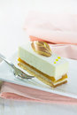 Vanilla cake slice on white dish Royalty Free Stock Photography