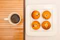 Vanilla with chocolate chips muffins with a cup of coffee on white plate Royalty Free Stock Photography