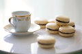 Vanilla and chocolate french macarons with tea cup Royalty Free Stock Photography
