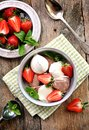 Vanilla and chocolate ice cream with organic strawberries. Rustic style. Royalty Free Stock Photo